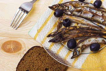 Sprats and bread on a plate