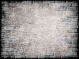 Monochrome grunge background with brick frame.