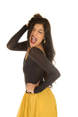 Brunette woman standing posing with a funny expression her mouth