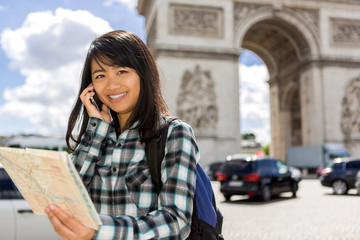 Young attractive asian tourist visiting Paris
