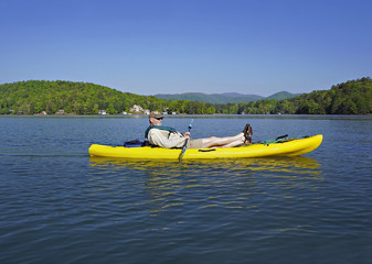 Older man in Kayak on Mountain Lake