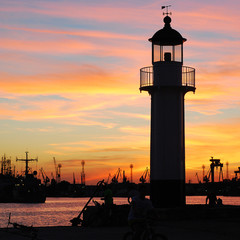 Sunset in the harbor overlooking the old lighthouse