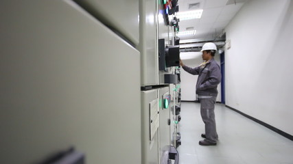 Electrical technician working in substation