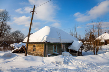 An old snow covered house