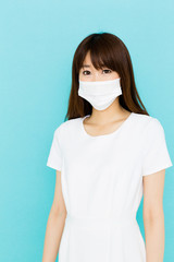 attractive asian nurse on blue background