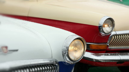 Old-fashioned cars in the rain.