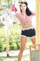 Pin up, vintage style photo of woman doing laundry