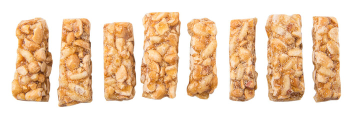 Caramelized candy nuts over white background