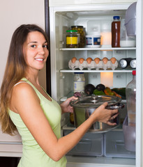 Woman near refrigerator