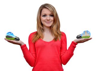 girl holding in hand eco energy bulbs