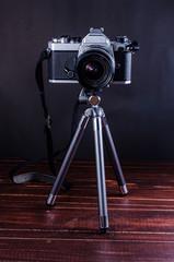 vintage camera on mini tripod
