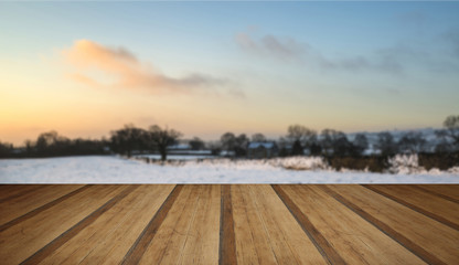 Beautiful snow covered sunrise Winter rural landscape with woode