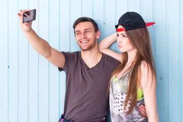 Couple friends taking selfie together wearing summer clothes