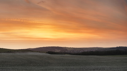 Stunning beautiful sunset over farm landscape with vibrant coors