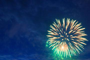 Colorful triple-burst of fireworks.