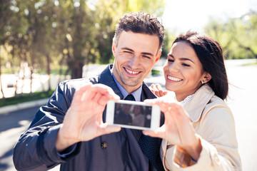 Smiling couple making selfie photo