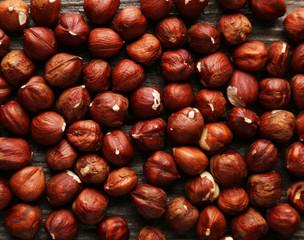 Hazelnuts on brown wooden background