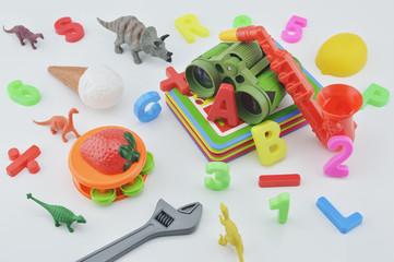 Plastic toys on white background, children education concept