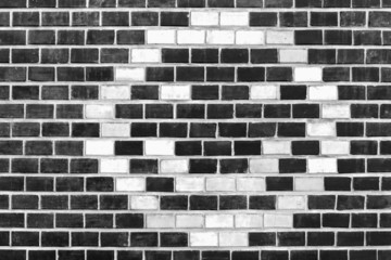Background of smiley pattern on brick wall.