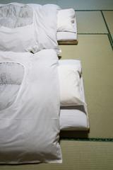 Futon bed on tatami flooring in Japanese ryokan