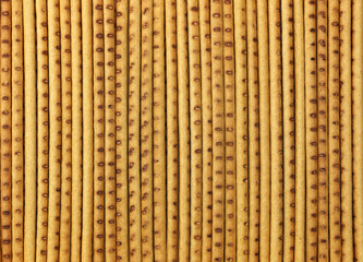 Background in the form of straight long crispy baked straw.