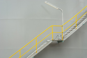 Stair beside tank for opertion service.
