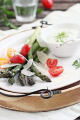Green asparagus with tomatoes,parmesan and herbs dip.
