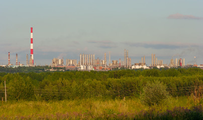 Summer evening landscape with petrochemical processing plants