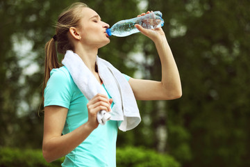 Image of young woman drinking water