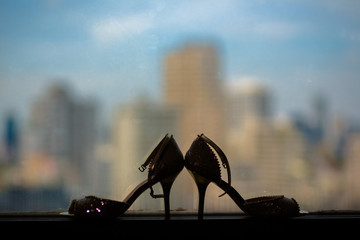 Silhouette Wedding Shoe with beautiful city background