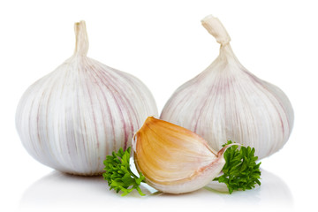 Garlic and parsley leaves isolated on white