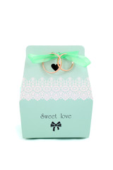 isolated wedding bonbonniere with candies and wedding rings