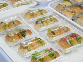 Bread, Salad and pork pack in plastic box, for meeting break.