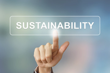 business hand clicking sustainability button on blurred backgrou