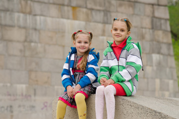 Sisters sitting on a granite ramp