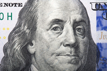 Portrait of former U.S. President Benjamin Franklin on the hundr