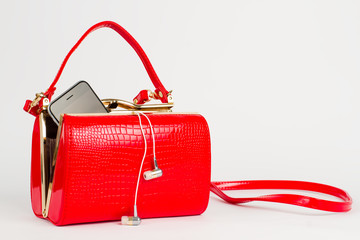 Red lacquered handbag.