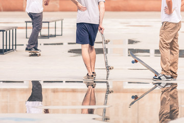 handsome guys with skateboard at freestyle park outdoors