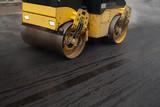road roller flattening new asphalt