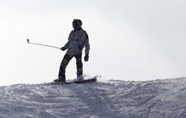 man snowboarding in the snow