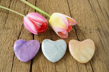 Three stone hearts and two tulips