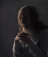 Senior Prayer, Old Man Praying with Folded Hands in Dark