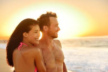 Romantic happy couple lovers on beach honeymoon