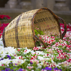 Wooden basket on a colorful flower garden