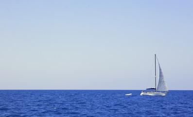 Sailboat on Vast Blue Ocean