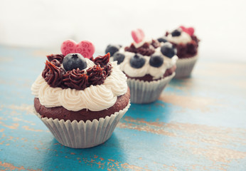 Decorated Cupcakes in a Row
