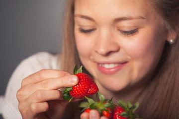 Smiling Girl Holding Fresh Red Strawberries