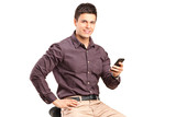 Man sitting on chair and holding mobile phone