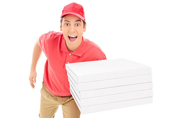 Fast pizza delivery guy running isolated on white