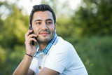 Casual man on mobile phone calling. Outdoors, outside
